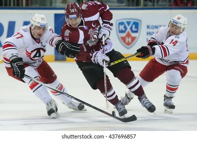 RIGA, LATVIA - OCTOBER 29: D.Megalinsky (77) and A.Simakov (14) of try to stop L.Darzins (10) in KHL game between Dinamo Riga and Avtomobilist Jekaterinburga played on OCTOBER 29, 2015 in Arena Riga