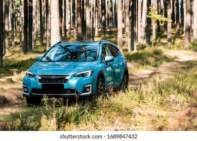 Riga / Latvia - September 09 2019: Subaru XV e-Boxer outdoors on dirt road during sunny sumer day