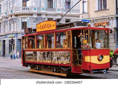 Riga, Latvia - September 1, 2018: People in Old tram in the street of Riga in Latvia.