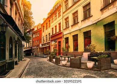 Riga, Latvia - September 10, 2017: Old medieval morning narrow street. Retro styled.