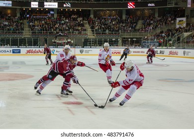 RIGA, LATVIA - SEPTEMBER 13:  Charles Genoway (55) tries to protect the puck from Gints Meija (87) in the KHL game between Dinamo Riga and Jokerit, played on September 13, 2016 in Arena Riga