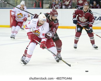 RIGA, LATVIA - SEPTEMBER 13:  Colton Gillies (81) of Dinamo Riga tries to stop Peter Regin (93) in the KHL game between Dinamo Riga and Jokerit, played on September 13, 2016 in Arena Riga
