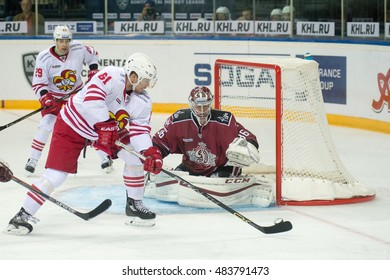 RIGA, LATVIA - SEPTEMBER 13:  Huhtala Tommi (61) tries to score the goal in the KHL game between Dinamo Riga and Jokerit, played on September 13, 2016 in Arena Riga