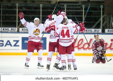 RIGA, LATVIA - SEPTEMBER 13:  Players of Jokerit celebrate the wining goal in  the KHL game between Dinamo Riga and Jokerit, played on September 13, 2016 in Arena Riga