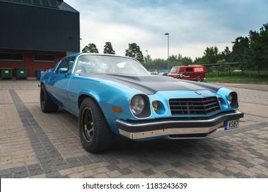 RIGA, LATVIA - SEPTEMBER 2018: Vintage blue Chevrolet Camaro parked at city street.