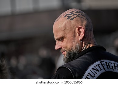 Riga, Latvia - September 22, 2020: Bikers celebrated the opening of motorcycling season by ride over city. Man with tattoo on his head
