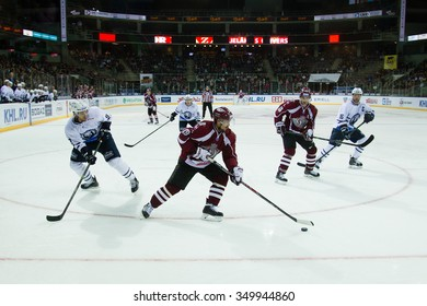 RIGA, LATVIA - SEPTEMBER 23:  Mikelis Reddish (19) controls the puck  in KHL game between Dinamo Riga and Medvescak Zagreb played on SEPTEMBER 23, 2015 in Arena Riga