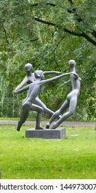 Riga, Latvia, September 4, 2017: Park sculpture three graces roundelay reminiscent of red dancers Henri Matisse in Riga, Latvia