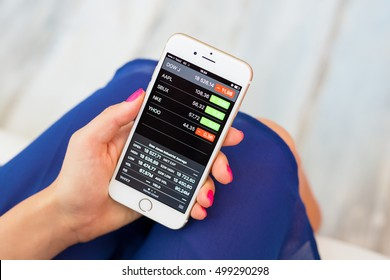 RIGA, LATVIA - SEPTEMBER 8, 2016: Apple Stocks app on iPhone lets users to keep track of their investment portfolio.