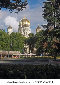 RIGA, LATVIA-SEPT. 27: The domes of The Nativity of Christ Orthodox Cathedral are seen as tourist dine and relax in Riga, Latvia, Europe on September 27, 2015.