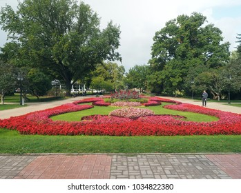 RIGA, LATVIA-SEPT. 27:  Vermanes Garden park with grass, flowers and tourists is seen by National Opera House in Riga, Latvia, Europe on September 27, 2015.