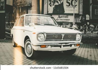 Riga, LV 05.09.2017. - White Toyota Corolla 1970 with dark background.