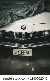 Riga, LV - 08.16.2018.: Vintage white BMW e24 found in garage under blanket.