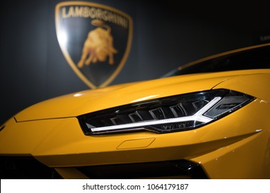 Riga, LV - APR 8, 2018: Lamborghini Urus headlight in front of Lamborghini logo