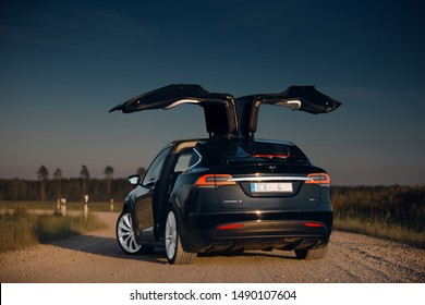 Riga, LV - AUG 27, 2019: Tesla Model X P100D with open falcon wings doors at the evening