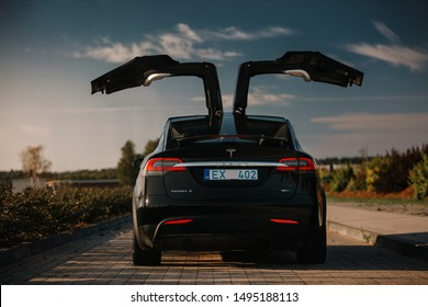 Riga, LV - AUG 27, 2019: Tesla Model X P90D with open falcon wings doors at the evening