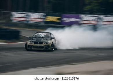 Riga, LV, Bikernieki Raceway - JUN 29, 2018: Drift Challenge Battle of Nations 2018 BMW M3 E92 HGK Eurofighter kit car rides on raceway