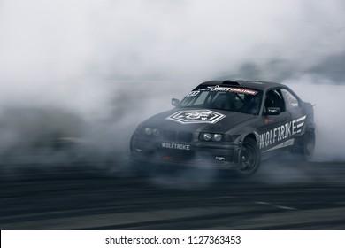 Riga, LV, Bikernieki Raceway - JUN 29, 2018: Drift Challenge Battle of Nations 2018 BMW M3 E36 HGK kit car rides on raceway