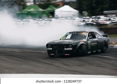 Riga, LV, Bikernieki Raceway - JUN 29, 2018: Drift Challenge Battle of Nations 2018 Nissan S14 Silvia Rocket Bunny Boss Monster Energy in drift