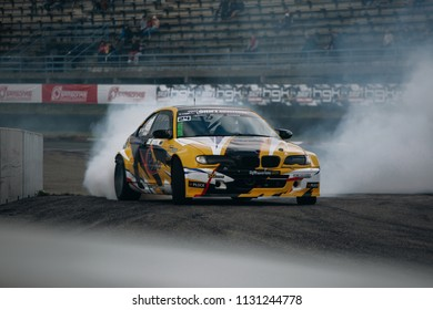 Riga, LV, Bikernieki Raceway - JUN 29, 2018: Drift Challenge Battle of Nations 2018 BMW M3 HGK drift car in race with smoke