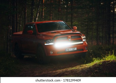 Riga, LV - JUL 16, 2020: Dodge Ram 1500 5.7 HEMI at the forest with led bar