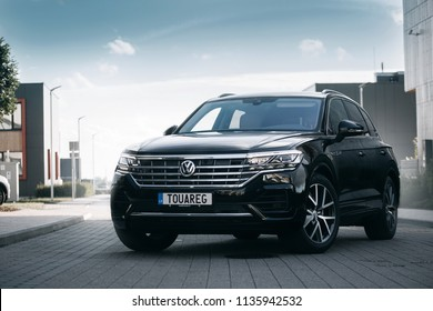 Riga, LV - JUL 5, 2018: New Volkswagen Touareg R- Line Highline 2018 on parking of modern house