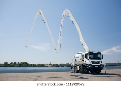Riga, LV - JUN 01, 2018: Man TGS 35 420 CIFA Truck mounted concrete pump with decomposed boom of concrete mixer with hydraulic foot stabilizer support