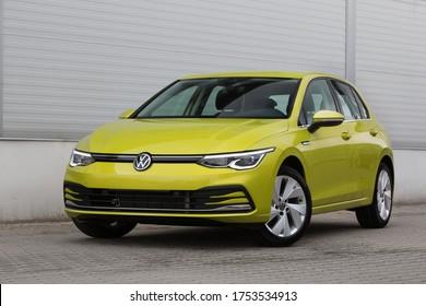 Riga, LV - JUN 10, 2020: Volkswagen Golf 8 MK8 2020 near warehouse wall