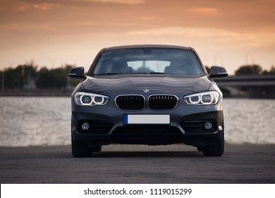 Riga, LV - JUN 14, 2018: BMW 140d 1-series F20 near river at evening