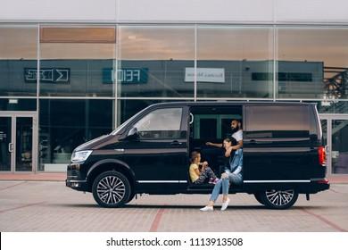 Riga, LV - JUN 15, 2018: Volkswagen Multivan Executive in parking with happy family