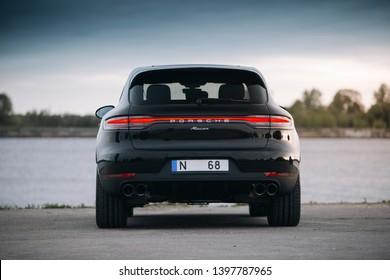 Riga, LV - MAY 14, 2019: Porsche Macan 2019 near river