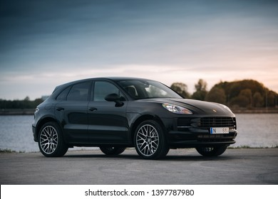 Riga, LV - MAY 14, 2019: Porsche Macan 2019 near river