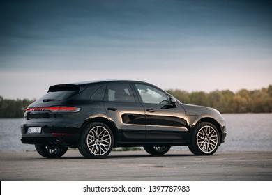 Riga, LV - MAY 14, 2019: Porsche Macan Turbo S near river