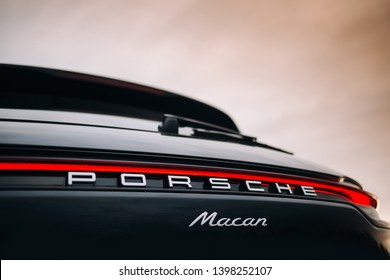 Riga, LV - MAY 14, 2019: Porsche Macan 2019 logo and led taillight