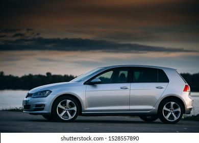 Riga, LV - SEP 17, 2019: Volkswagen Golf MK7 near river at the sunset