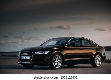 Riga, LV - SEP 2, 2019: Audi A6 Quattro at the evening near river