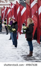 RIGA - MARCH 16: Young girl at Commemoration of Latvian Waffen SS unit. Event is drawing nationalists & demonstrators. Many Latvians were forcibly called in SS. March 16, 2010, Riga, Latvia.
