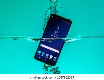 RIGA, MARCH 2018 - Newly launched Samsung Galaxy S9 Plus smatrphone  is displayed for editorial purposes - partially submerged in water to demonstrate it's waterproof design
