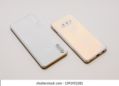 RIGA, MMAY 2019 - Recently launched HUAWEI P30 LITE smartphone is displayed together with SAMSUNG GALAXY S10e for editorial purposes