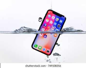 RIGA, NOVEMBER 5 - Newly launched Apple iPhone X is displayed for editorial purposes - partially submerged in water to demonstrate it's waterproof design
