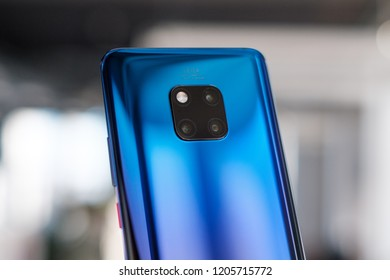 RIGA, OCTOBER 2018 - Recently launched Huawei Mate 20 Pro smartphone is displayed for editorial purposes. Shallow focus effect.