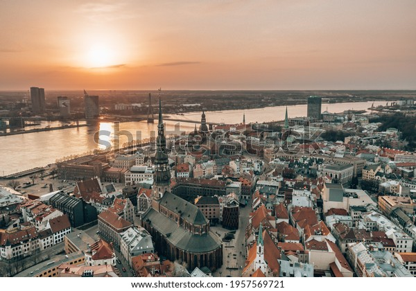 RIga rooftop view panorama at sunset with urban architectures and Daugava River. View of the old town