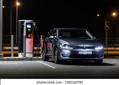 Riga,Latvia 26 April 2019 Volkswagen Golf (facelift) Seventh generation MK7 e-Golf  85 kW electric motor charging battery at parking slot night time city
