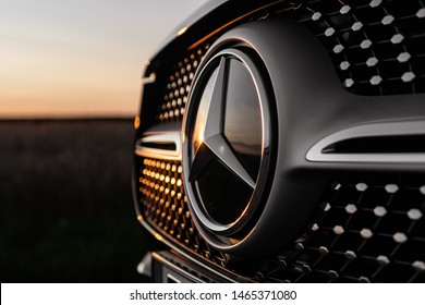 Riga,Latvia 26 July 2019, Mercedes GLE-Class AMG Fourth generation V167, Countryside fields, sunset time with lens  flare, Mercedes front grill  view.