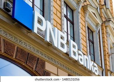 Riga/Latvia - August 16, 2019: Logo of PNB Banka (previously – Norvik Banka) on the banks office in Riga. PNB Banka is one of the oldest commercial banks in Latvia