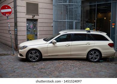 Riga/Latvia July 5, 2019 Beige taxi car Mercedes-Benz  E-class wagon at the city street.