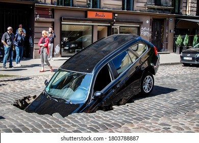 Riga/Latvia - June 5, 2020: Car fell into sinkhole which had opened after street surfacing caved in on Gertrudes Street during hydraulic tests