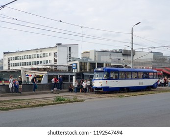 Riga/Latvia - September 9, 2018: Tram stop near the central market and bus station in Riga, tram at the tram stop, people get on the tram