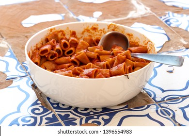 Rigatoni Amatriciana sauce, traditional Italian pasta sauce based on guanciale (cured pork cheek), pecorino cheese from Amatrice, tomato (San Marzano tomatoes, specifically), white wine, black pepper