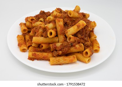 Rigatoni Pasta with a Hearty Bolognese Sauce on a White Plate with a White Background